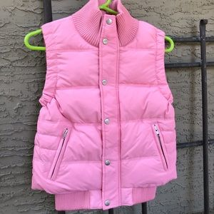 Look at this cutie!  Pink puffer vest!